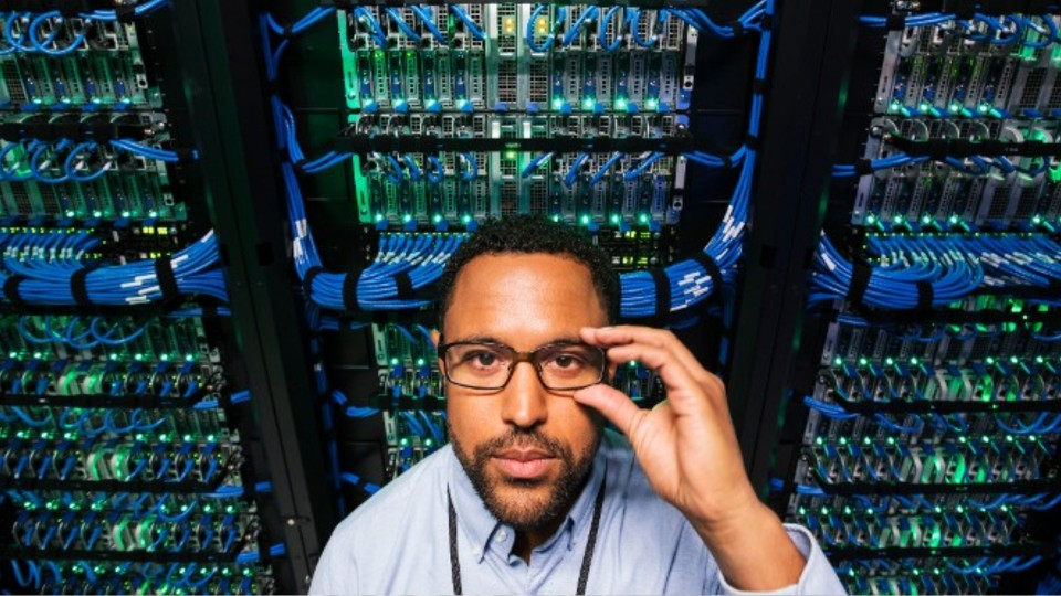 man standing in a server room
