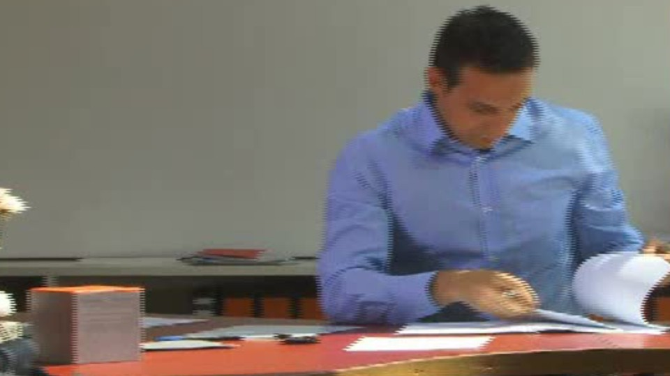 person looking at a printed document
