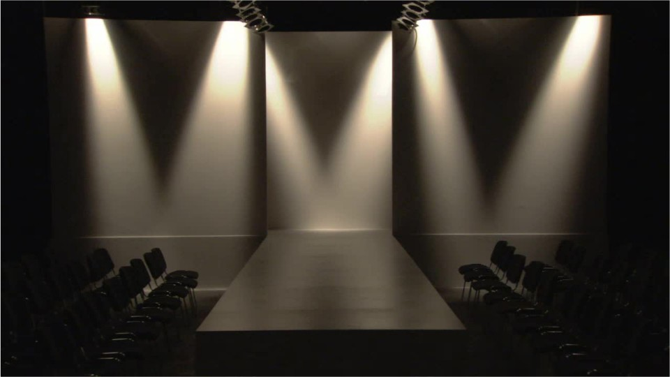 empty stage and theater with accent lighting on backdrop