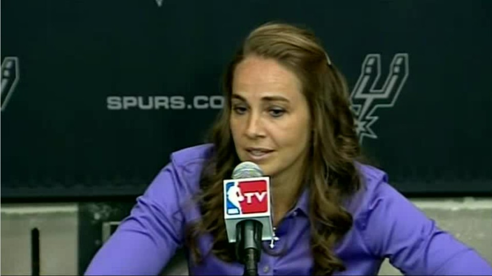 female NBA coach being interviewed by press
