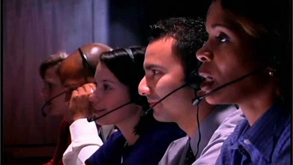 group of call center eworkers wearing phone headsets