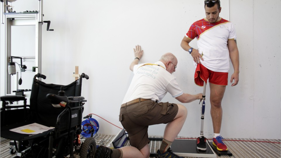 person making adjustments to an artificial leg